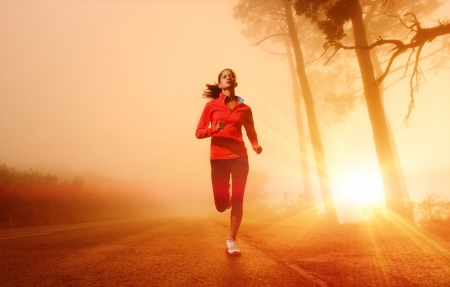 Photo pour Athlete running on the road in morning sunrise training for marathon and fitness  Healthy active lifestyle latino woman exercising outdoors   - image libre de droit