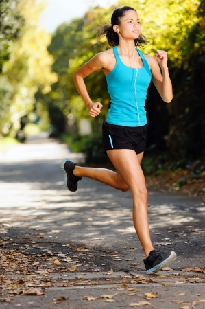 running healthy fitness woman training for marathon outdoors in alleyway  vitality lifestyle exercise athlete