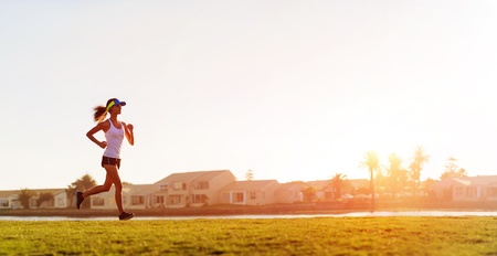 Athlete running at sunset panorama with copyspace