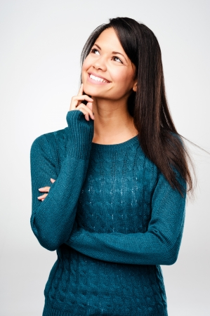 cheerful woman thinking and looking up with high aspirations