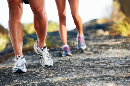 trail running marathon fitness feet on rock fitness and healthy lifestyleの写真素材