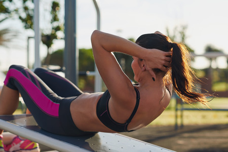 Foto de fitness woman doing situps in outdoor gym woking out strength training - Imagen libre de derechos