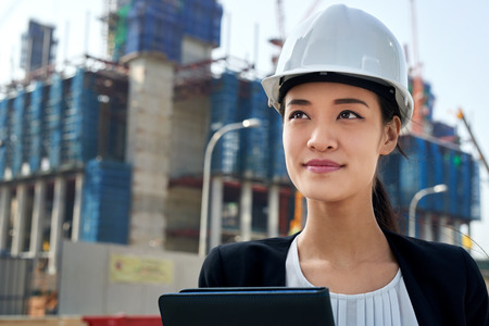 Photo pour professional asian chinese business woman supervising construction site with hard hat protection at work - image libre de droit