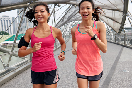 Photo pour asian chinese happy women enjoying a run together for morning outdoor workout - image libre de droit