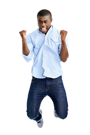 Photo for celebration jump of african man with arms out shouting - Royalty Free Image