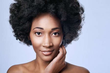 Portrait of beautiful young black african model in studio with smooth complexion flawless skin