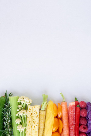 colorful food background, frame border of rainbow spectrum gradient of organic fresh fruit and vegetablesの写真素材
