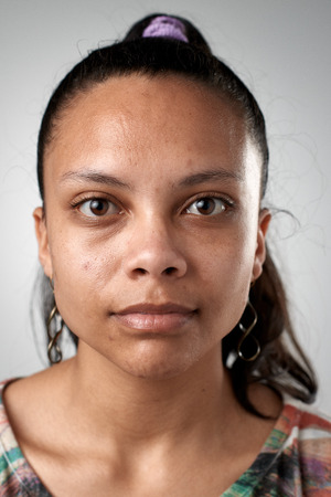 Photo pour Portrait of real hispanic woman with no expression ID or passport photo full collection of diverse face and expressions - image libre de droit