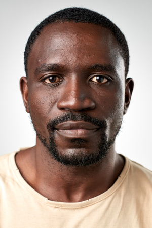 Foto de Portrait of real black african man with no expression ID or passport photo full collection of diverse face and expressions - Imagen libre de derechos