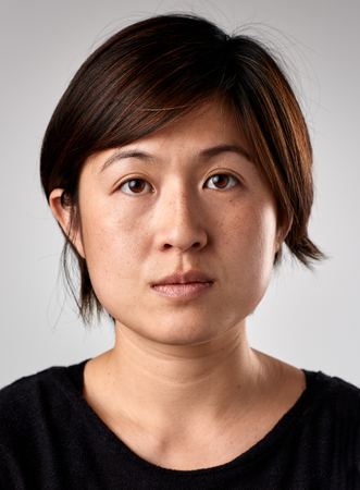 Foto de Portrait of real chinese asian woman with no expression ID or passport photo full collection of diverse face and expressions - Imagen libre de derechos