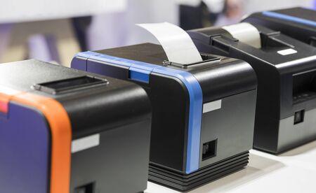 Photo pour paper slip exit from thermal printer ; business background  - image libre de droit