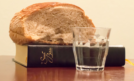 French Bible with bread and water