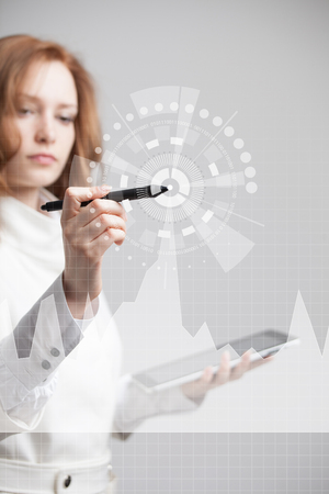 Young businesswoman with stylus working with graph chart. Future technologies for busines, stock market concept.