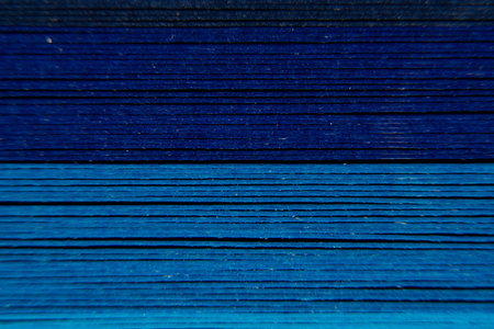 Photo for Blue horizontal strips as a colorful backdrop. The colored paper on a background. - Royalty Free Image