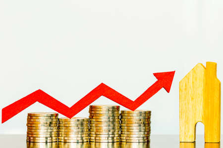 Photo pour Home model and red arrow graph with growing value put on the gold coin put on the desk in the office, for currency and financial business investment and fund real estate concept. - image libre de droit