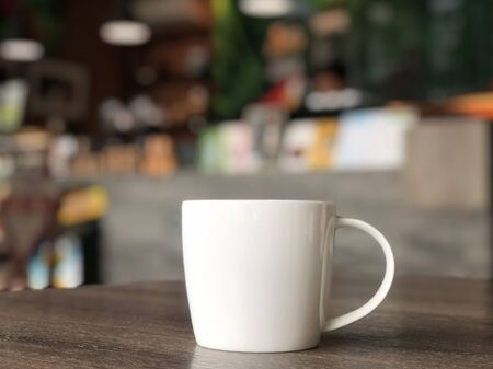 Photo pour white coffee mug on the table in the cafe shop with colorerful blurred background - image libre de droit