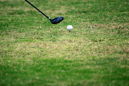 Golf equipment,golf ball with tee on course.