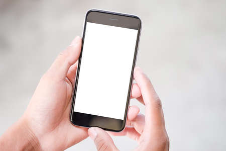 Photo pour Cropped shot view of man hands holding smart phone with blank copy space screen for your text message or information content, female reading text message on cell telephone during in urban setting. - image libre de droit