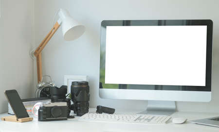 Photo pour Mock up computer with white screen and medium format camera on designer or photographer table. Photographer or designer workspace. - image libre de droit