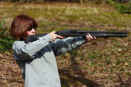 Woman with a shotgun