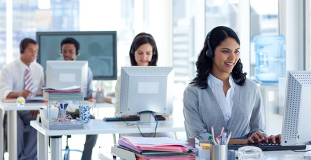 Businesswoman in a call center with her colleagues