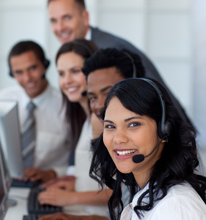 Portrait of a businesswoman in a call center with her team