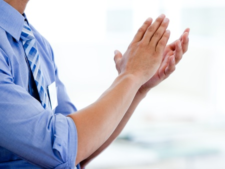 Close-up of a businessman clapping