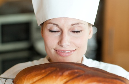 Radiant female chef baking bread