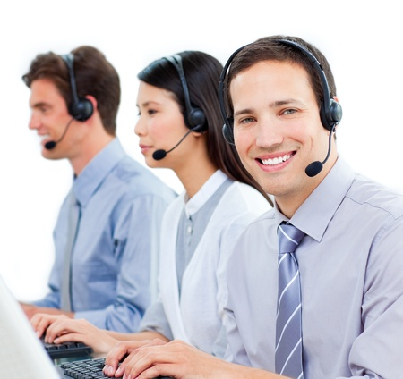 Smiling business team working at computer