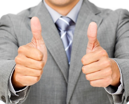 Close-up of a businessman with thumbs up