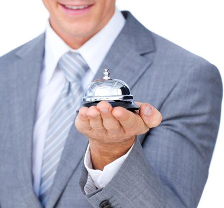 Foto für Close-up of a businessman holding a service bell  - Lizenzfreies Bild