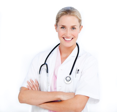 Caucasian female doctor folding arms against white background