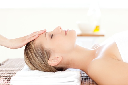 Photo for Close-up of a relaxed woman receiving a head massage  - Royalty Free Image