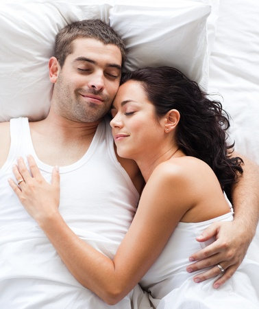 Boyfriend and girlfriend together in bed