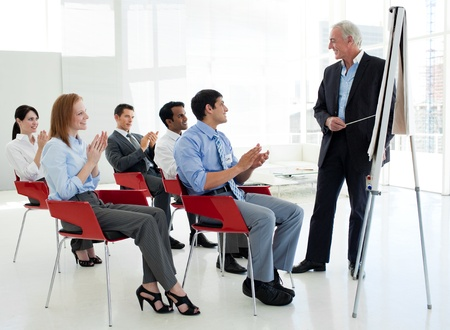 Business people applauding at the end of a conference