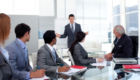 Confident businessman giving a presentation to his team