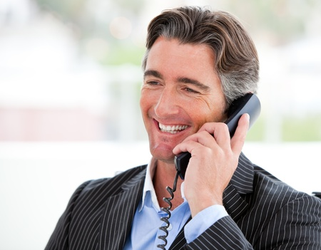 Portrait of a smiling businessman on phone