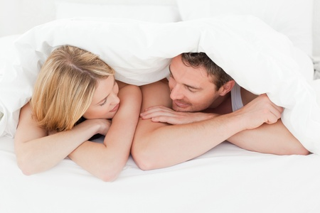 Photo for Lovely couple in their bed - Royalty Free Image