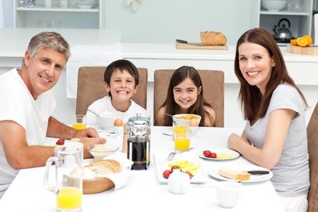 Family having breakfast in the kitchen
