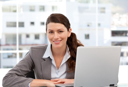 Smiling woman on the computer looking at the camera