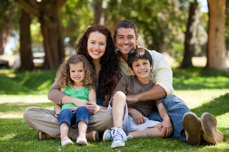 Photo for Happy family sitting in the garden - Royalty Free Image