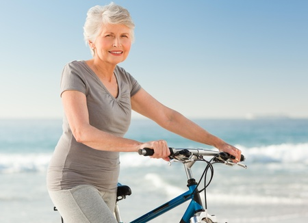 Photo for Senior woman with her bike - Royalty Free Image