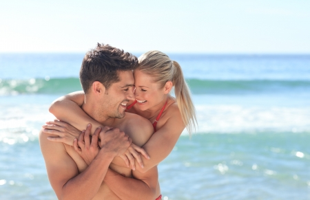 Photo for Happy lovers at the beach - Royalty Free Image