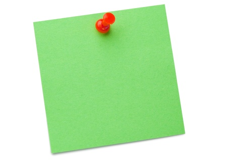 Green post-it with drawing pin on a white background