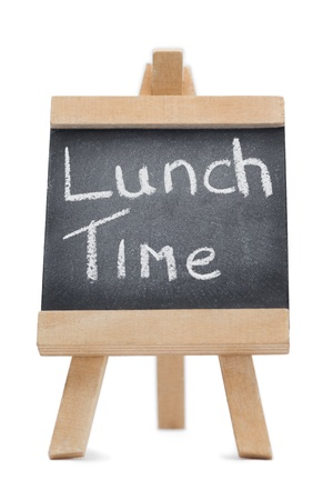 Chalkboard with the words lunch time written on it isolated against a white background