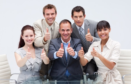 Confident business team with thumbs up