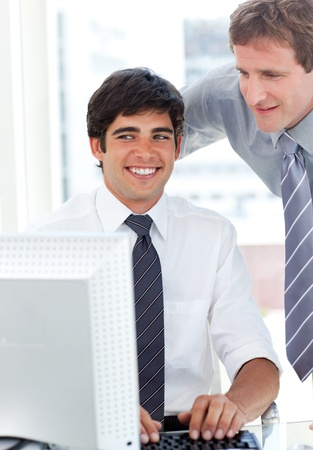 Charming businessman working at a computer with his manager