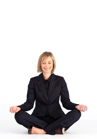 Businesswoman meditating on the floor