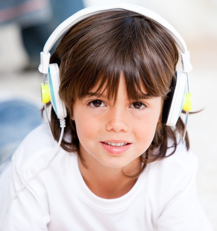 Smiling boy listening music