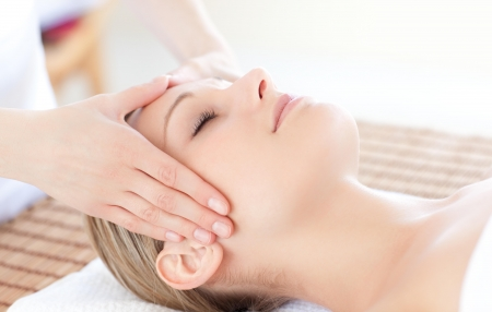 Close-up of a bright woman receiving a head massage